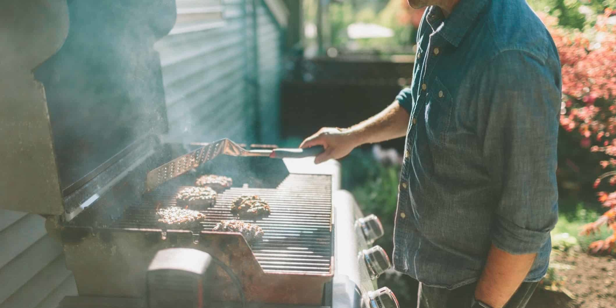 a-man-barbecuing-burgers-in-the-backyard_t20_ko9o9P (1)